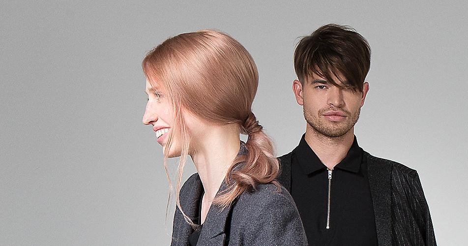 Mann und Frau mit aktuellen Frisurentrends.