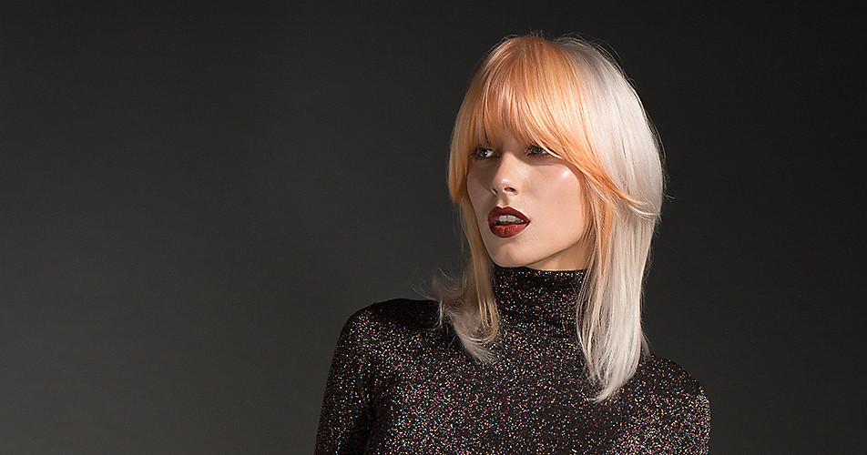 Überlange Pony-Frisur in Weiß-Blond und Pastell.